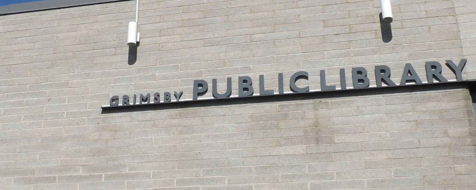 Sign on side of Grimsby Public Library building