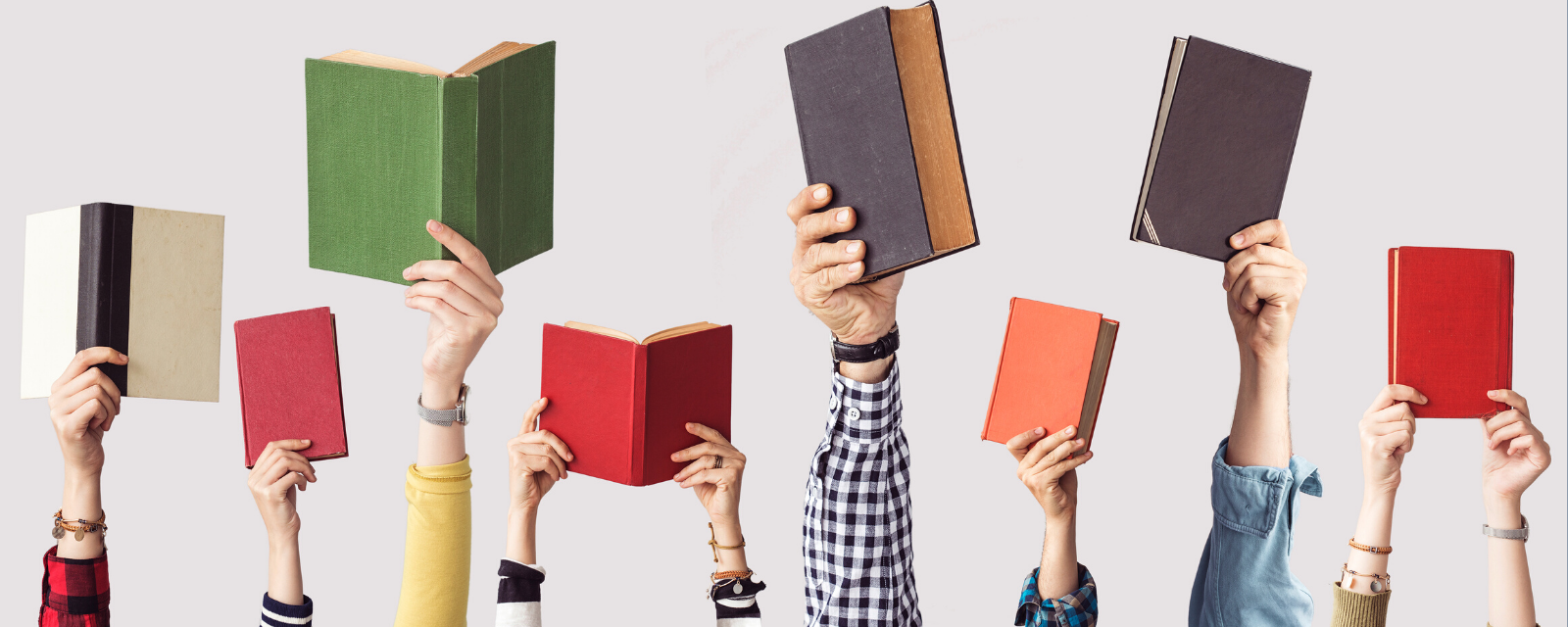people's arms sticking up each holding a different book