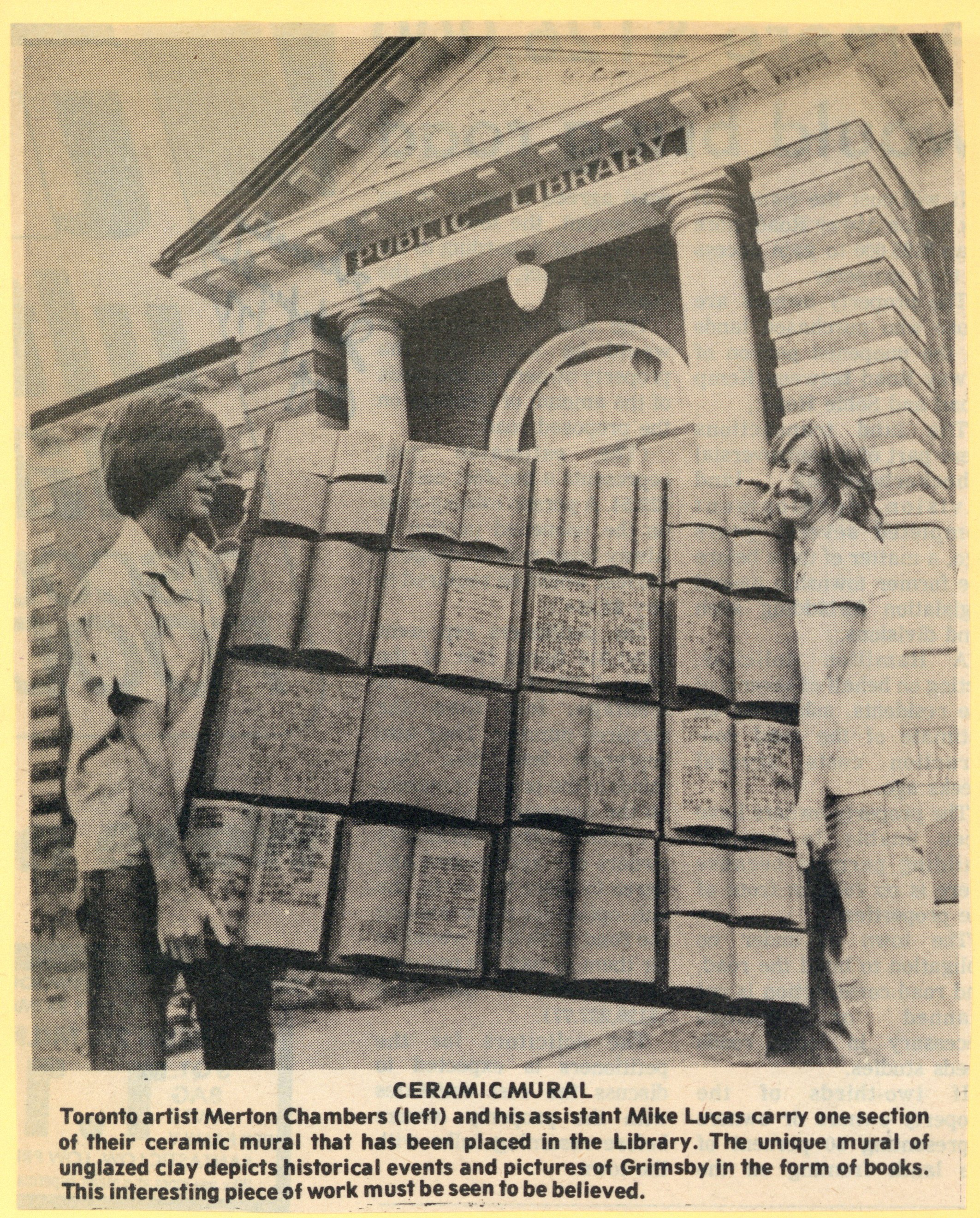 News clipping of Toronto artist Merton Chambers delivering his clay book mural