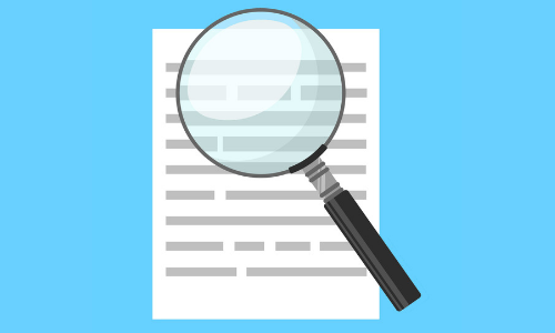 Magnifying glass over paper on blue background