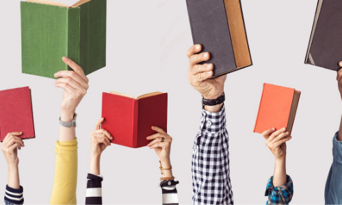 People's arms up in a row each holding a book