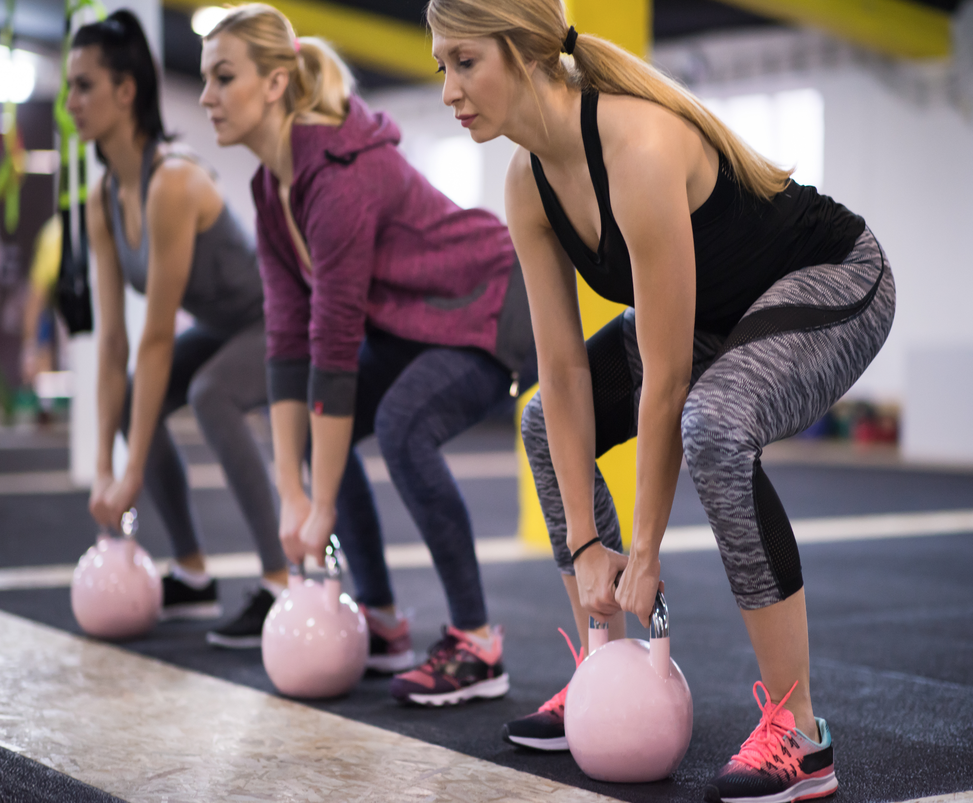 Women lifting Kettlebells