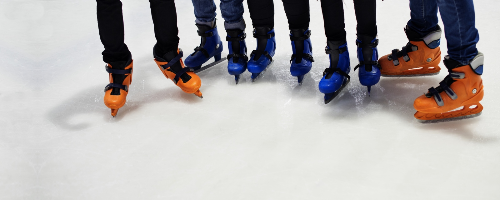 close-up images of skaters on ice with colourful skates